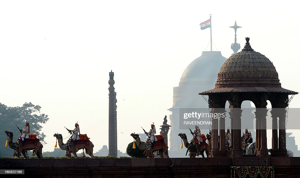 Members of the Border Security Force (BSF) stand guard on camels at the Central Secretariat and Parliament buildings during the Beating Retreat Ceremony at Vijay Chowk in New Delhi on January 29, 2013. The ceremony is a culmination of Republic Day celebrations and dates back to the days when troops disengaged themselves from battle at sunset.