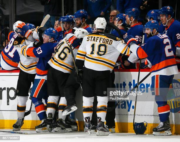 Members of the Boston Bruins and New York Islanders tussle during the second period at the Barclays Center on March 25 2017 in Brooklyn borough of...