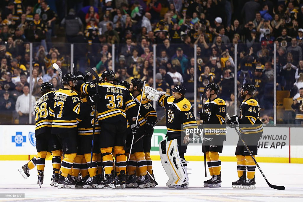 Members of the Boston Bruins celebrate after a shootout against the Tampa Bay Lightning at TD Garden on March 12 2015 in Boston Massachusetts The...
