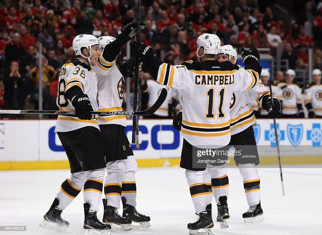 Members of the Boston Bruins including Jordan Caron and Gregory Campbell celebrate a second period goal against the Chicago Blackhawks at the United...