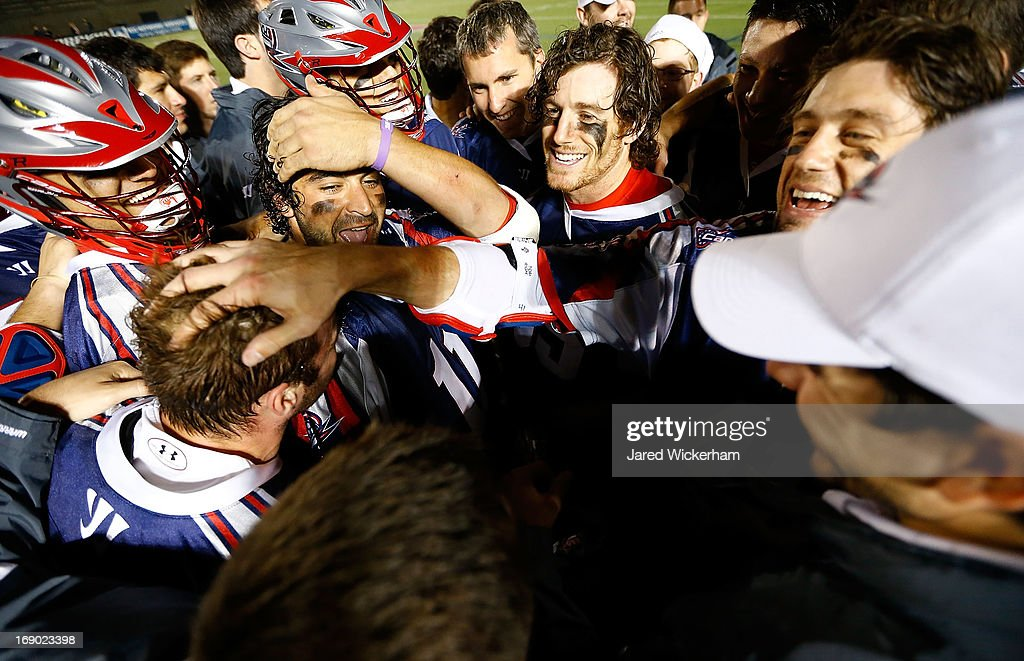 Members of the Boston Cannons celebrate in a huddle after scoring the game-winning goal in overtime against the Chesapeake Bayhawks during the game on May 18, 2013 at Harvard Stadium in Boston, Massachusetts.
