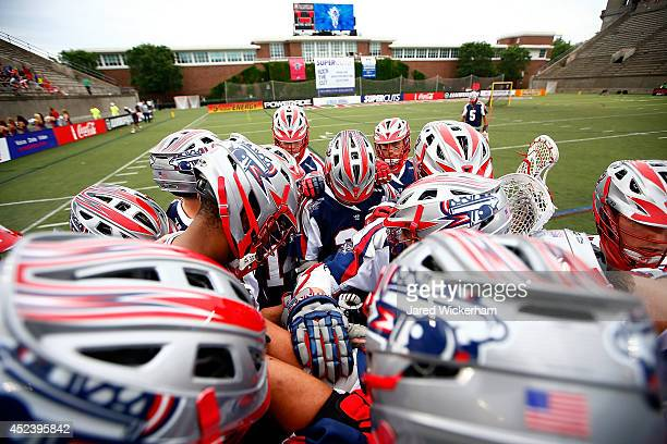 Members of the Boston Cannons huddle together prior to the game against the New York Lizards during the game at Harvard Stadium on July 19 2014 in...