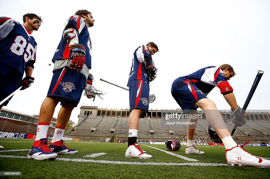 Members of the Boston Cannons line up during the national anthem prior to the game against the Denver Outlaws at Harvard Stadium on May 10, 2014 in Boston, Massachusetts.