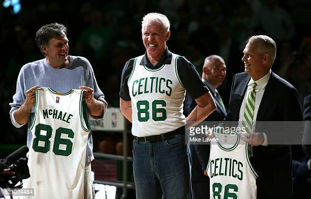 Members of the Boston Celtics 1986 championship team Kevin McHale Bill Walton and Danny Ainge are honored at halftime of the game between the Boston...