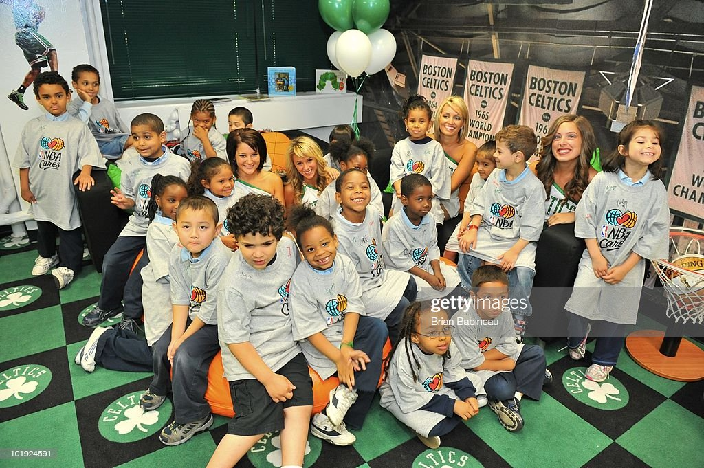 Members of the Boston Celtics dance team pose with children during the unveiling of the Learn & Play Center at the Boston Centers for Youth & Families (BCYF) Tobin Community Center on June 9, 2010 in Boston, Massachusetts.