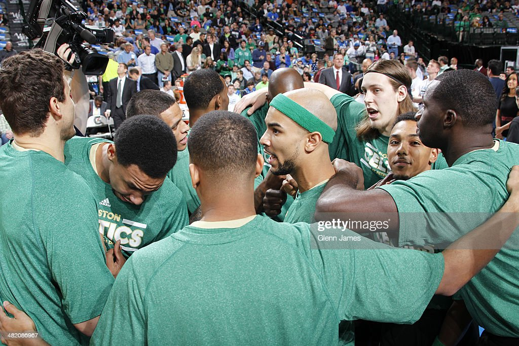 Members of the Boston Celtics huddle up before the game against the Dallas Mavericks on March 17, 2014 at the American Airlines Center in Dallas, Texas.