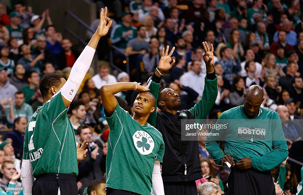Members of the Boston Celtics including Jared Sullinger #7, Leandro Barbosa #12 , Jeff Green #8, and Kevin Garnett #5 celebrate after their team made a 3-point shot against the Memphis Grizzlies during the game on January 2, 2013 at TD Garden in Boston, Massachusetts.