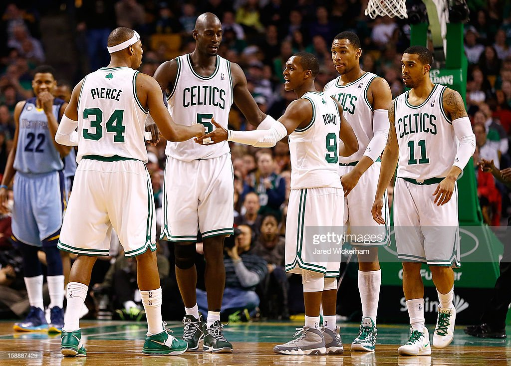 Members of the Boston Celtics including Rajon Rondo #9, Kevin Garnett #5, Paul Pierce #34, Jared Sullinger #7, and Courtney Lee #11 huddle during the game against the Memphis Grizzlies on January 2, 2013 at TD Garden in Boston, Massachusetts.