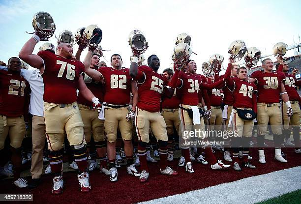 Members of the Boston College Eagles celebrate their 287 win against the Syracuse Orangemen during the game at Alumni Stadium on November 29 2014 in...
