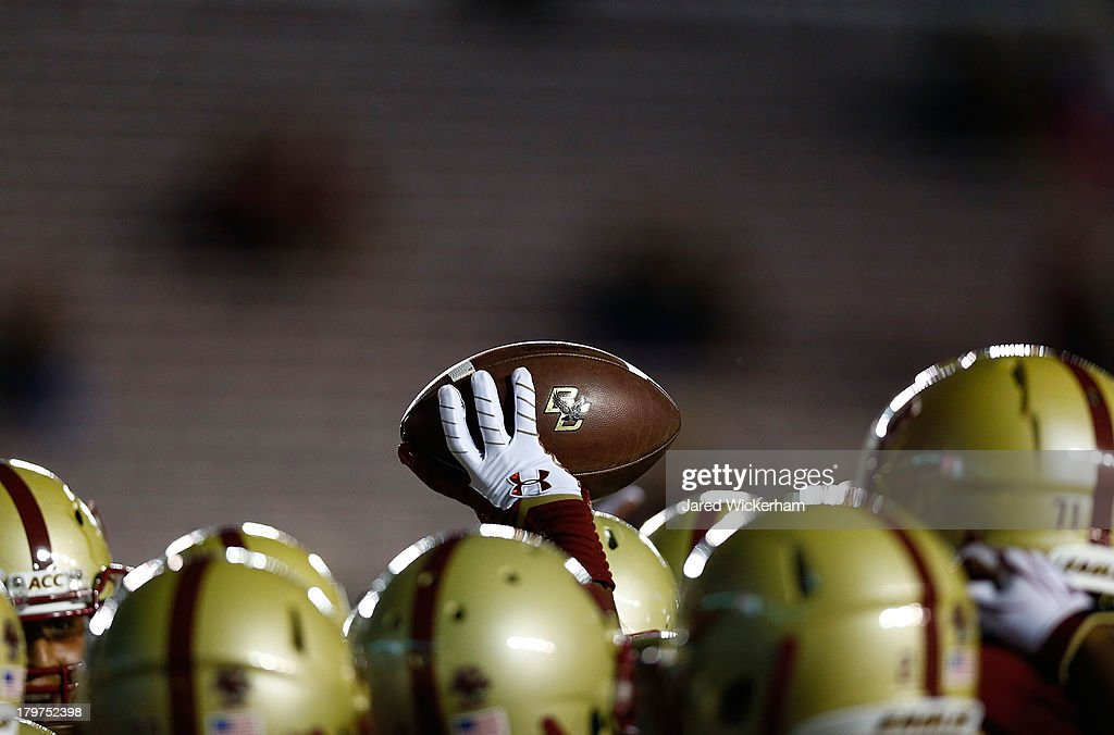 Members of the Boston College Eagles huddle prior to the game against the Wake Forest Demon Deacons on September 6, 2013 at Alumni Stadium in Chestnut Hill, Massachusetts.