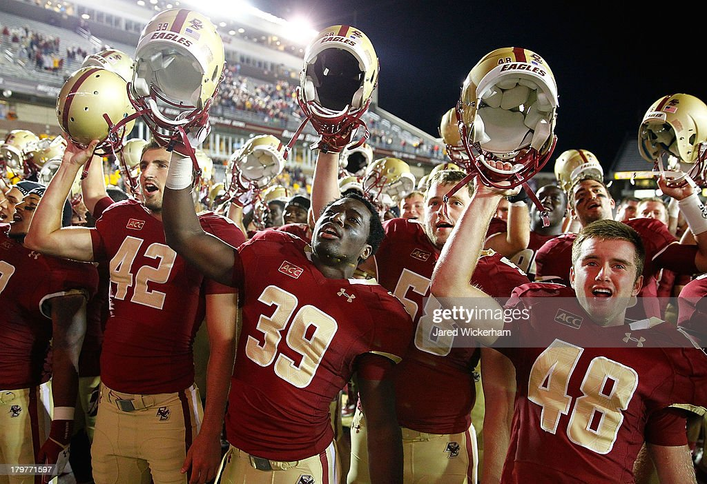Members of the Boston College Eagles including Alex Howell #42, Atem Ntantang #39, and Jake Wilhelm #48 celebrate following a 24-10 win against the Wake Forest Demon Deacons during the game on September 6, 2013 at Alumni Stadium in Chestnut Hill, Massachusetts.