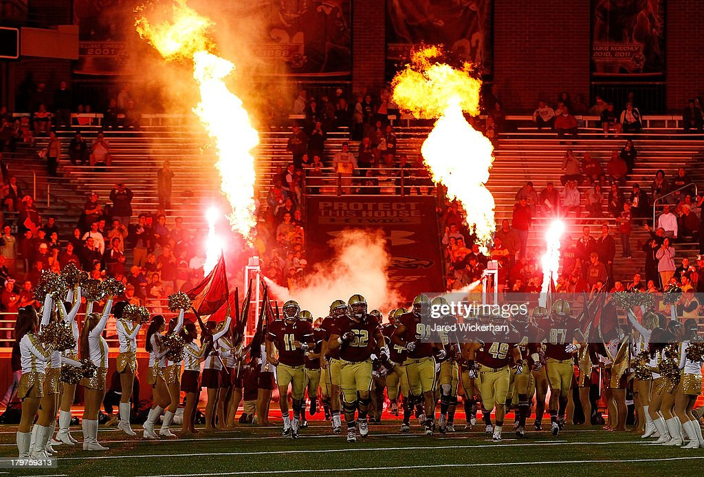 Members of the Boston College Eagles take the field prior to the game against the Wake Forest Demon Deacons on September 6, 2013 at Alumni Stadium in Chestnut Hill, Massachusetts.