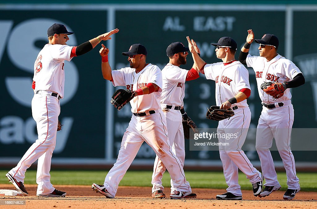 Members of the Boston Red Sox including Shane Victorino #18, Daniel Nava #29, and Jacoby Ellsbury #2 celebrate following their 3-1 win against the Baltimore Orioles during the Opening Day game on April 8, 2013 at Fenway Park in Boston, Massachusetts.