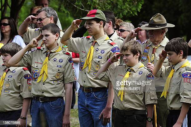 Members of the Boy Scouts salute during the raising of the flag on May 25 2009 at the Willow River Cemetery in Hudson Wisconsin during Memorial Day...