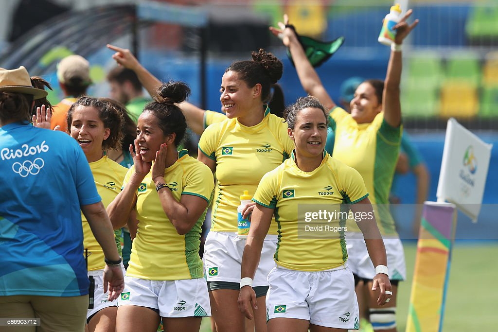Members of the Brazil team celebrate after defeating Japan in the Women's Pool C rugby match on Day 2 of the Rio 2016 Olympic Games at Deodoro...