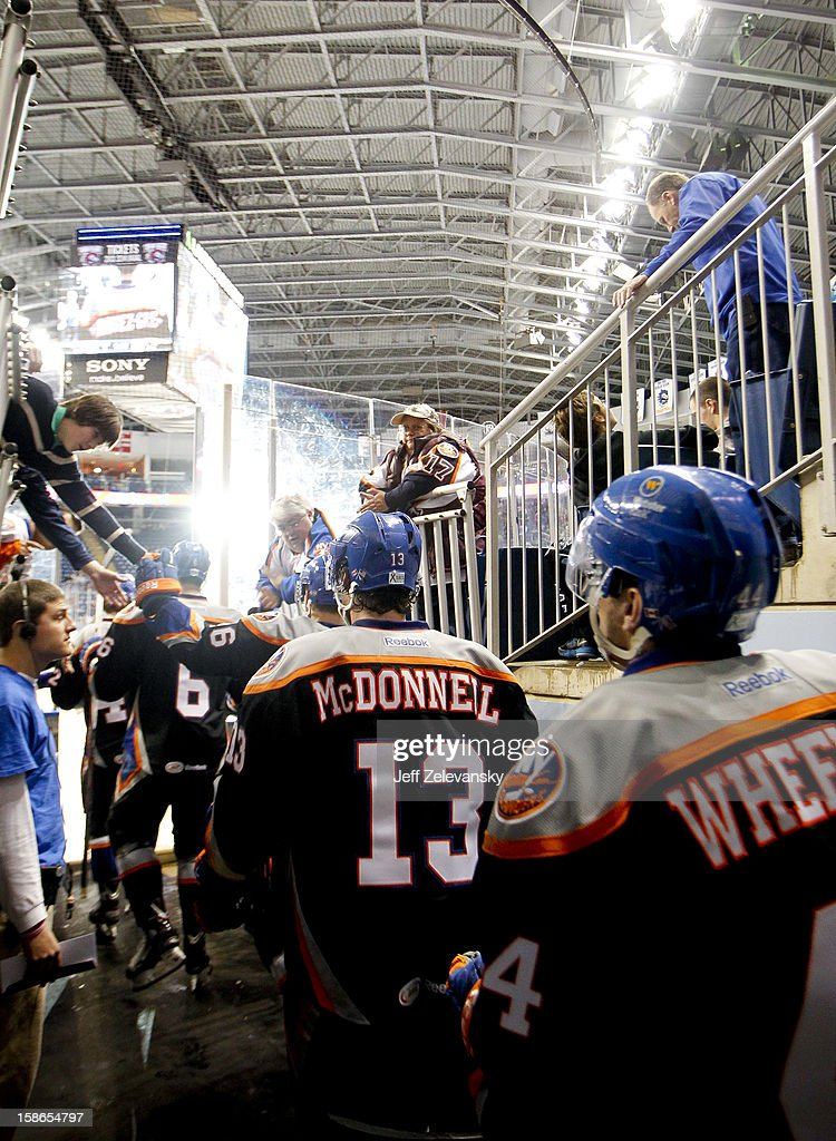 Members of the Bridgeport Sound Tigers wear jerseys emblazoned with the names of Sandy Hook Elementary School shooting take the ice during an an American Hockey League game against the Adirondack Phantoms at Webster Bank Arena at Harbor Yard on December 22, 2012 in Bridgeport, Connecticut.
