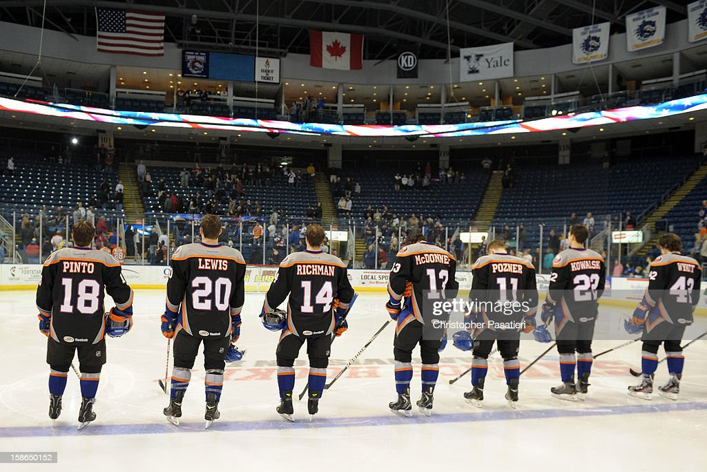 Members of the Bridgeport Sound Tigers wear jerseys with the names of Sandy Hook Elementary School shooting victims as they stand for the National Anthem prior to an American Hockey League game against the Adirondack Phantoms on December 22, 2012 at the Webster Bank Arena at Harbor Yard in Bridgeport, Connecticut.