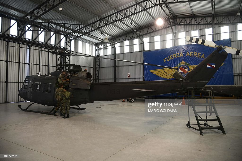 Members of the Brigade 1 of the Uruguayan Air Force restore a helicopter at the hangar in Montevideo, Uruguay on February 26, 2013. AFP PHOTO/Mario Goldman