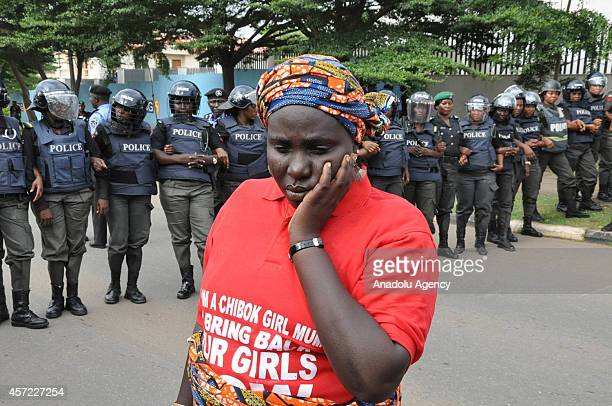 Members of the Bring Back Our Girls campaign gather to walk to President Goodluck Jonathan's official residence in Abuja to keep up the pressure on...