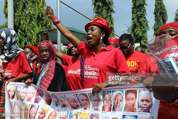 Members of the Bring Back Our Girls group campaigning for the release of the Chibok schoolgirls kidnapped by Boko Haram Islamists march to meet with...
