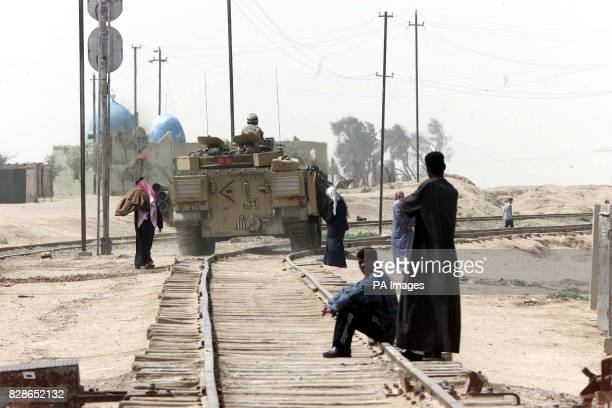 Members of the British Army bring humanitarian relief to the people of Imam Anas a settlement south of the city of Basra The troops were concerned...
