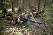 Members of the British Duke of Lancaster's Regiment engage the enemy in a firefight with blank bullets while participating in the NATO 'Spring Storm'...