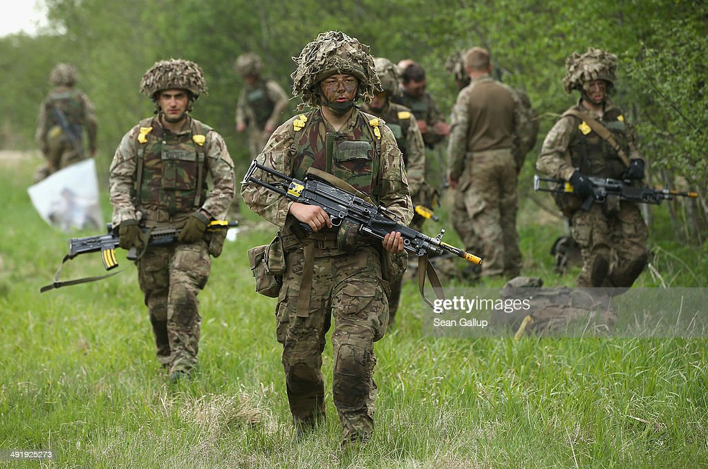 Members of the British Duke of Lancaster's Regiment prepare to move out for an operation while participating in the NATO 'Spring Storm' military...