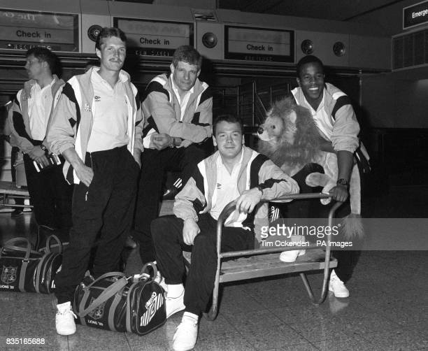 Members of the British Lions squad at Heathrow Airport waiting to jet to Australia to start their tour From left unidentified Paul Dean captain...