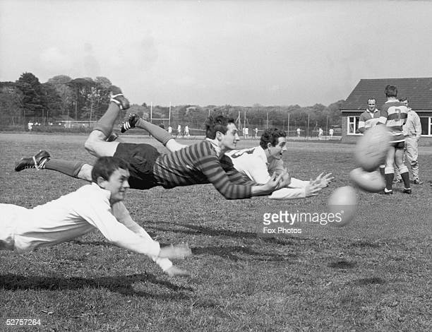 Members of the British Lions touring team practising scrum half passing during a training session at Eastbourne 9h May 1968 Left to right Roger Young...