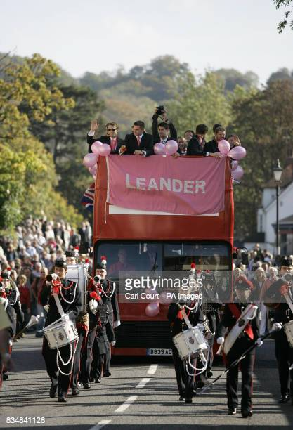 Members of the British Olympic rowing team wave as they ride on an opentop bus during an Olympic Rowing Heroes Return Party was held in their honour...