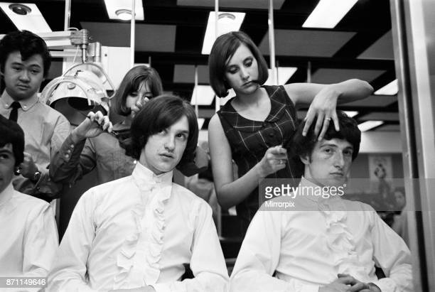 Members of the British pop group The Kinks having their hair styled at a salon 12th June 1964