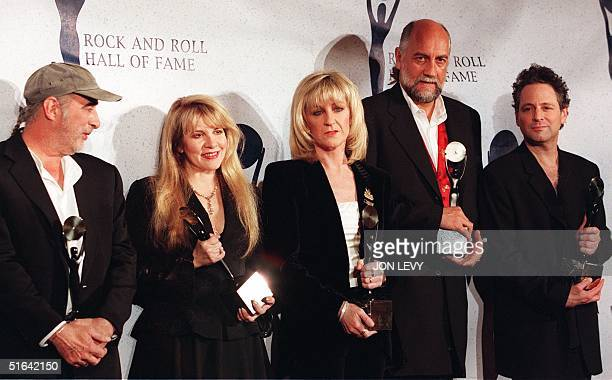 Members of the British rock group Fleetwood Mac John McVie Stevie Nicks Christine McVie Mick Fleetwood and Lindsay Buckingham appear together after...