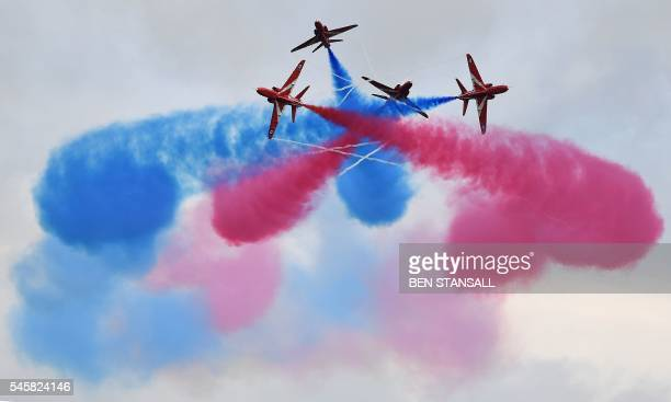 TOPSHOT Members of the British Royal Air Force Aerobatic Team the Red Arrows perform ahead of the British Formula One Grand Prix at Silverstone motor...