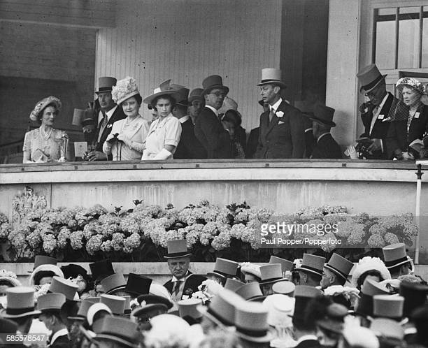 Members of the British Royal family in the Royal Box at Ascot Racecourse the Duchess and Duke of Gloucester Queen Elizabeth Princess Elizabeth and...
