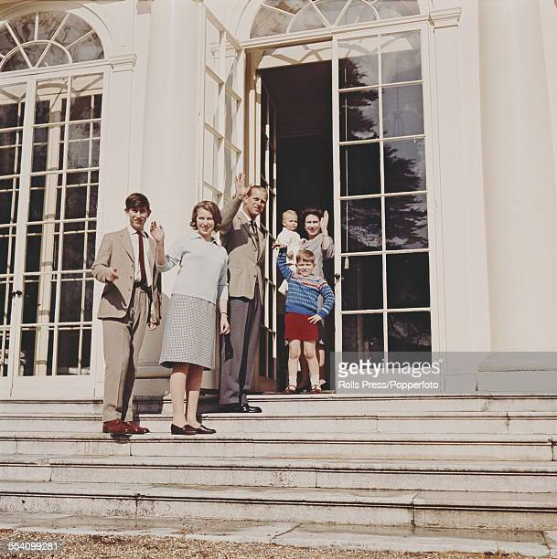 Members of the British Royal Family including from left to right Queen Elizabeth II holding Prince Edward Prince Andrew Prince Philip Duke of...