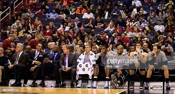Members of the Brooklyn Nets sit on the bench during the closing minutes of their 11477 loss to the Washington Wizards at Verizon Center on February...