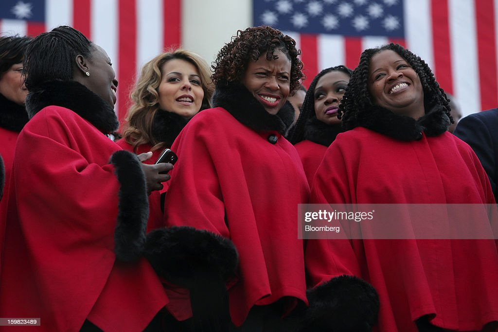 Members of the Brooklyn Tabernacle Choir share a laugh before the start of the U.S. presidential inauguration in Washington, D.C., U.S., on Monday, Jan. 21, 2013. As he enters his second term President Barack Obama has shed the aura of a hopeful consensus builder determined to break partisan gridlock and adopted a more confrontational stance with Republicans. Photographer: Scott Eells/Bloomberg via Getty Images