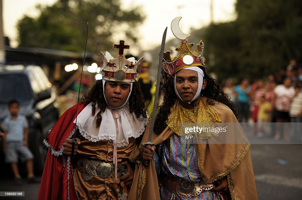 Members of the brotherhood of Saint Sebatian Matyr participate in the dance of The Moors and Christians in the town of Apastepeque, 50 kms east from San Salvador, El Salvador on January 16, 2013. The members of the Saint Sebastian brotherhood dance in the honor of the co-patron saint of Apatepeque. The Moors and Christians dance tells the adventures of the crusadaders and is celebrated from more than 300 years ago. AFP PHOTO/ Jose CABEZAS