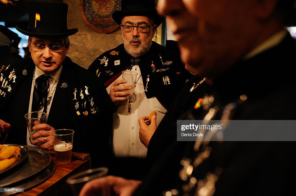 Members of the Brotherhood of the ''Burial of the Sardine'' enjoy tpas and beverages at a local bar during the Burial of the Sardine procession on February 10, 2016 in Madrid, Spain. The Sardine procession is a centuries-old Spanish tradition made famous by a painting by Spanish artist Francisco de Goya called 'El Entierro de La Sardina'. The mourners hold a mock funeral procession mourning the end of Carnival through the heart of old 'Castizo' Madrid visiting and enjoying the wines and tapas of local taverns.