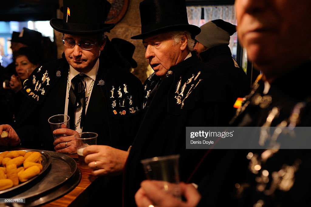 Members of the Brotherhood of the ''Burial of the Sardine'' enjoy tpas and red wine at a local tevern during the Burial of the Sardine procession on February 10, 2016 in Madrid, Spain. The Sardine procession is a centuries-old Spanish tradition made famous by a painting by Spanish artist Francisco de Goya called 'El Entierro de La Sardina'. The mourners hold a mock funeral procession mourning the end of Carnival through the heart of old 'Castizo' Madrid visiting and enjoying the wines and tapas of local taverns.