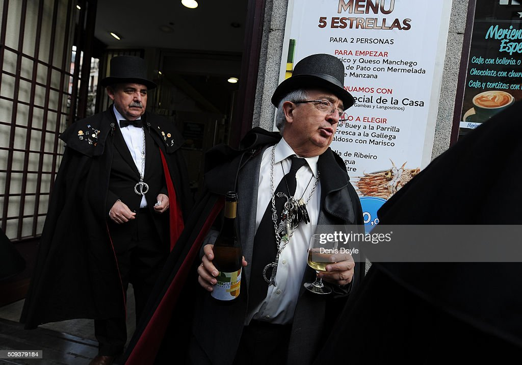 Members of the Brotherhood of the ''Burial of the Sardine'' enjoys a bottle of white wine at a local tevern during the Burial of the Sardine procession on February 10, 2016 in Madrid, Spain. The Sardine procession is a centuries-old Spanish tradition made famous by a painting by Spanish artist Francisco de Goya called 'El Entierro de La Sardina'. The mourners hold a mock funeral procession mourning the end of Carnival through the heart of old 'Castizo' Madrid visiting and enjoying the wines and tapas of local taverns.