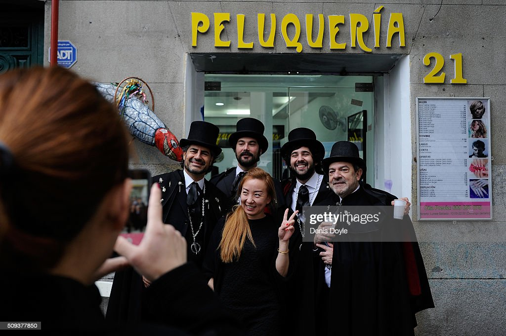 Members of the Brotherhood of the ''Burial of the Sardine'' pose for a portrait outside a Chinese hairdressers during the Burial of the Sardine procession on February 10, 2016 in Madrid, Spain. The Sardine procession is a centuries-old Spanish tradition made famous by a painting by Spanish artist Francisco de Goya called 'El Entierro de La Sardina'. The mourners hold a mock funeral procession mourning the end of Carnival through the heart of old 'Castizo' Madrid visiting and enjoying the wines and tapas of local taverns.