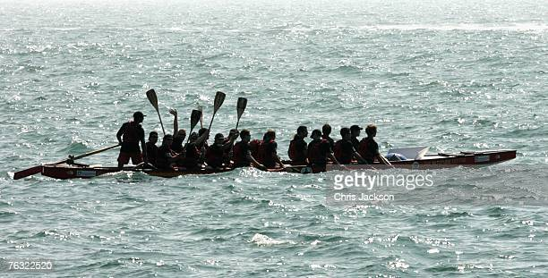 Members of the Brotherhood waves their paddles as they begin to race the Scion Sisterhood across the English Channel in a dragon boat on August 25...