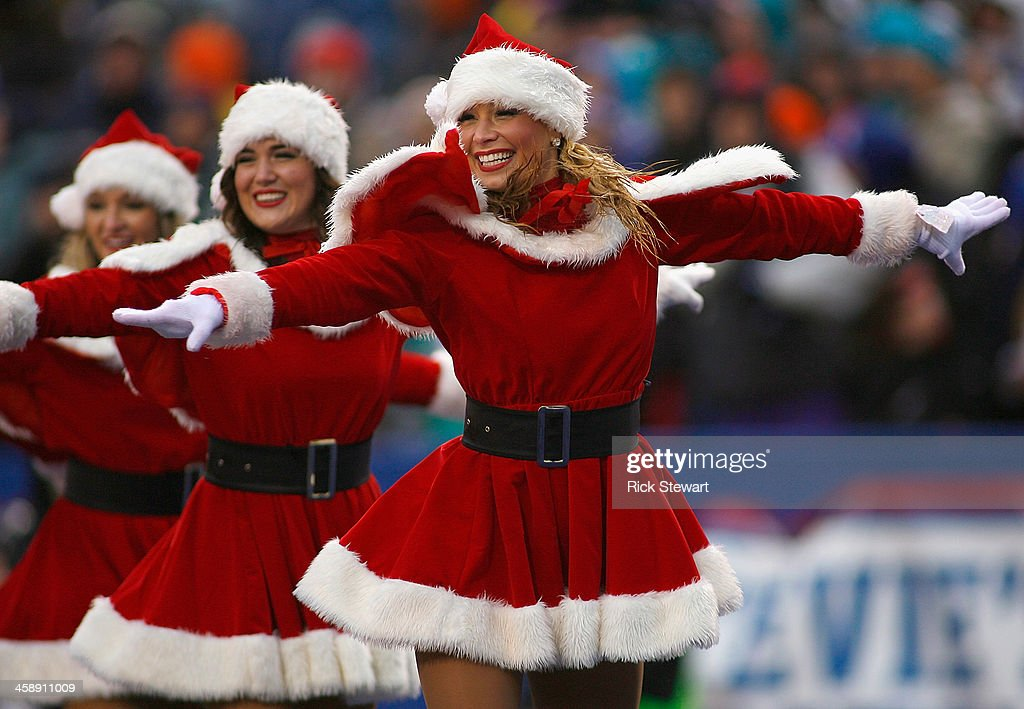 Members of the Buffalo Jills dance squad perform during a timeout between the Buffalo Bills and Miami Dolphins at Ralph Wilson Stadium on December 22, 2013 in Orchard Park, New York. Buffalo won 16-0.