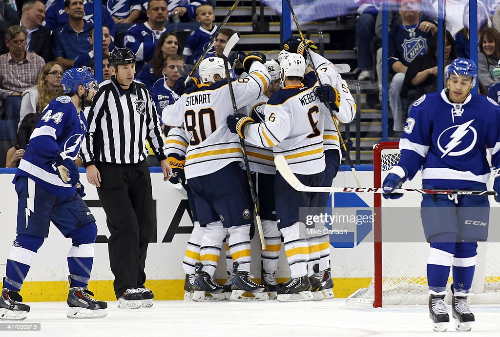 Members of the Buffalo Sabres celebrate a goal as Nate Thompson #44 and J.T. Brown #23 of the Tampa Bay Lightning react at the Tampa Bay Times Forum on March 6, 2014 in Tampa, Florida.