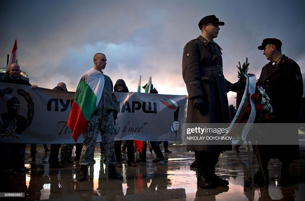 Members of the Bulgarian National Union dressed in a military uniform take part in a march in the centre of Sofia on February 13, 2016. Hundreds of Nationalists gathered to commemorate General Hristo Lukov, a Bulgarian army commander during the World War I, who was killed on February 13, 1943. / AFP / NIKOLAY DOYCHINOV