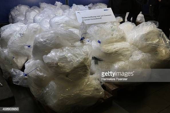 Members of the Bundeskriminalamt German law enforcement agency the Federal Criminal Office display portions of 29 tonnes of recentlyconfiscated...