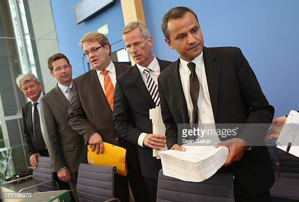Members of the Bundestag commission investigating the NSU murder series including chairman Sebastian Edathy and leading member Clemens Binninger...