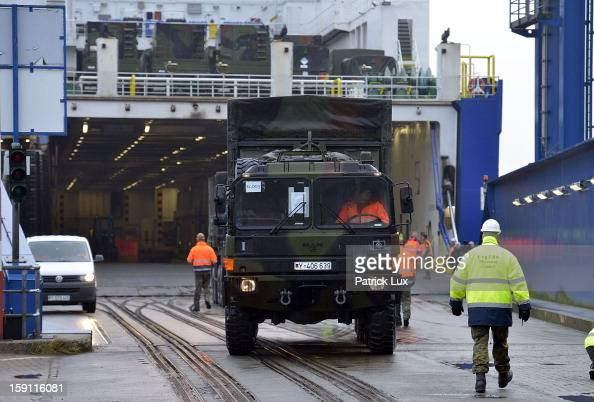 Members of the Bundeswehr Germany's armed forces load a Patriot antimissile system onto a ship for transport to Turkey on January 8 2013 in...
