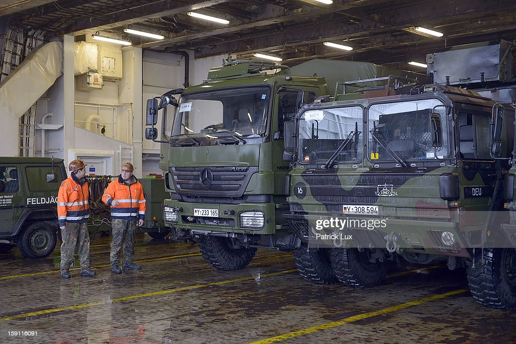 Members of the Bundeswehr, Germany's armed forces, load a Patriot anti-missile system onto a ship for transport to Turkey on January 8, 2013 in Travemunde, Germany. Germany is deploying two Patriot batteries and 400 troops as part of a NATO operation that also involves Dutch and U.S. Patriot units to defend Turkey from possible Syrian attack.